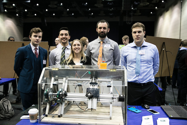 student group with machinery at Expo 2019